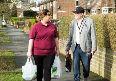 Neighbourhood Chaplains carry shopping